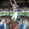 Frankie Dettori celebrates his first win at Saratoga aboard Aventure Love on July 18, 2014.<br /> Coglianese Photos/Chelsea Durand