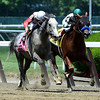 Norumbega with jockey Joel Rosario, left out duels Cat Burgler with Rosie Napravnik up to win the 126th running of The Brooklyn Invitational at Belmont Park June 7, 2014 in Elmont, N.Y.