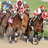 Rosie Napravnik aboard Vicar's In Trouble, right, heads into the backstretch at the Fair Grounds in New Orleans, LA  to go on and win the Louisiana Derby (GrII) Saturday, March 29, 2014. Owned by Kenneth and Sarah Ramsey and trained Mike Maker, the 3-year old colt ran the 1 1/8 miles in 1:50.77. Intense Holiday finished 2nd and Commanding Curve was 3rd. The value of the race was $1,000,000.<br /> Photo By Amanda Hodges Weir / Hodges Photograpy