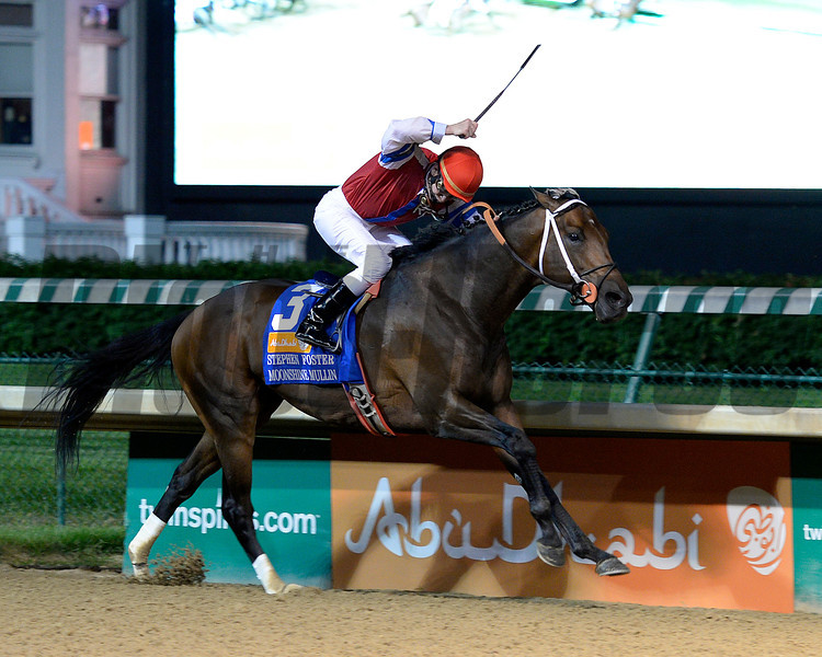 Caption:<br /> Moonshine Mullin with Calvin Borel wins the Stephen Foster (gr. I)  at Churchill Downs on June 14, 2014.<br /> Photo by Anne M. Eberhardt