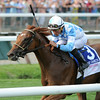 Free as a Bird wins the 2014 Smirnoff Sorbet Caress Stakes at Saratoga.<br /> Coglianese Photos/Adam Mooshian