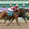 8/2/2014  -  I Dazzle with Jamie Theriot aboard gets a head in front to capture the 30th running of the Louisiana Cup Distaff at Louisiana Downs. Tensas Harbor with Colby Hernandez (red cap) was second and Dream Glider was third.   Hodges Photography / Lou Hodges, Jr.