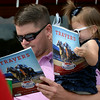 Father/daughter handicapping the TRavers<br /> photo by Anne M. Eberhardt