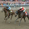 V. E. Day wins the 2014 Travers Stakes at Saratoga.<br /> Coglianese Photos/Chelsea Durand