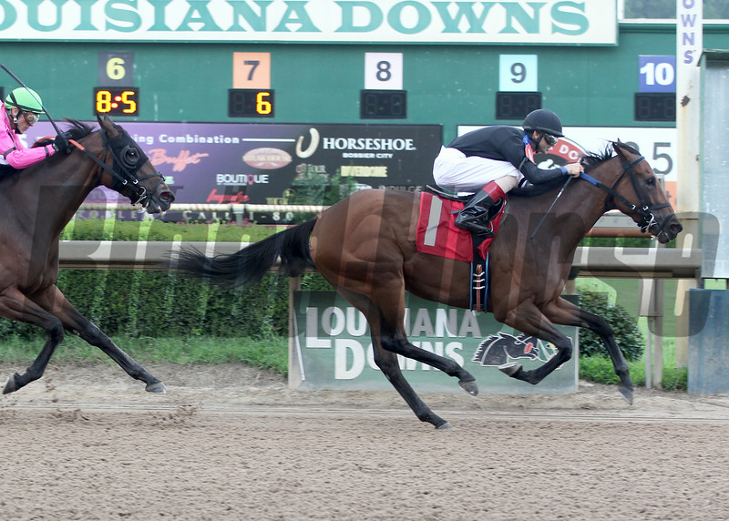 8/2/2014  -  Joe Patin, Jr. aboard Afternoon Tango pulls away from Snappy Girl and jockey Glen Murphy to win the 33rd running of the Louisiana Cup Filly and Mare Sprint at Louisiana Downs.   Hodges Photography / Lou Hodges, Jr.