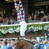 Frankie Dettori celebrates his first win at Saratoga aboard Aventure Love on July 18, 2014.<br /> Coglianese Photos/Chelsea Durand