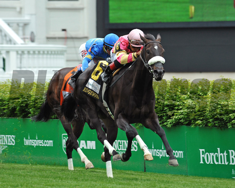 A Little Bit Sassy wins the 2014 Edgewood Stakes. Photo by Rick Samuels.
