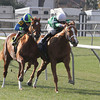 Kiss To Remember, 4, with Rosie Napravnik aboard pulls away from Miguel Mena and Adrianne G as they enter the stretch on the turf at the Fair Grounds Race Course and Slots in New Orleans, LA Saturday, February 1, 2014. The Maggi Moss owned and Tom Amoss trained Kiss To Remember went on to win the 2nd Running of the Battle of New Orleans Stake over the Stall Wilson turf course in 1:05.80 for the about 5 1/2 furlong race.<br /> Photo by Alexander Barkoff / Hodges Photography
