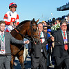 Jeff and Ken Ramsey, right of Real Solution, walking into the winner's Circle.<br /> Manhattan 1 Origs 848<br /> Anne M. Eberhardt photo