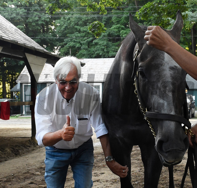 After giving Travers Stakes winner Arrogate a complete check up, trainer Bob Baffert gives a thumbs up Sunday morning in the barn area at the Saratoga Race Course August 28, 2016 in Saratoga Springs, N.Y.    (Skip Dickstein
