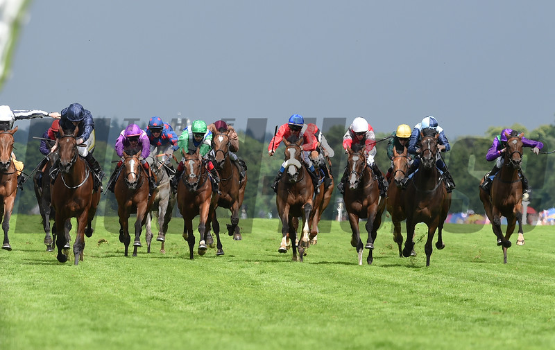Even Song (left, dark blue silks) wins the 2016 Ribblesdale Stakes.<br /> Mathea Kelley Photo