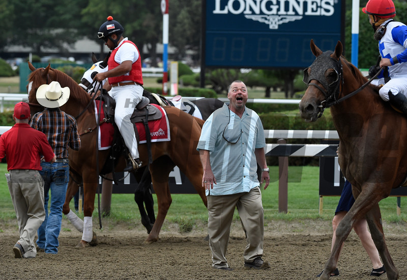 Trainer Eric Guillot, center shows his excitement after his charge Laoban broke his maiden and also dropped his jockey Jose Ortiz after the race and won the 53rd running of the Jim Dandy at Saratoga 7/30/16.  Photo by Skip Dickstein