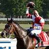 Jockey Mike Smith is exultant as he sits atop the undefeated Songbird after winning the 100th running of The Coaching Club American Oaks Sunday July 24 2016 at the Saratoga Race Course in Saratoga Springs, N.Y. (Skip Dickstein