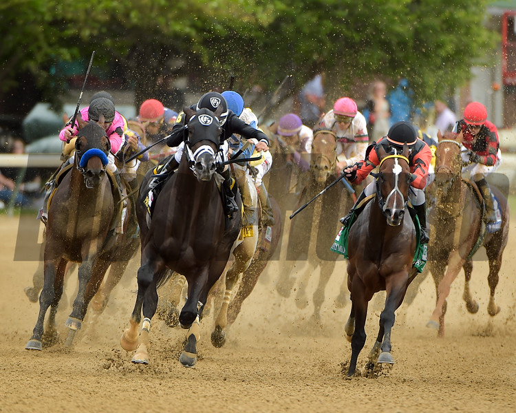Sharp Azteca (middle. black cap) leads the field around the final turn in The Pat Day Mile (g. III) with Edgard Zayas aboard.