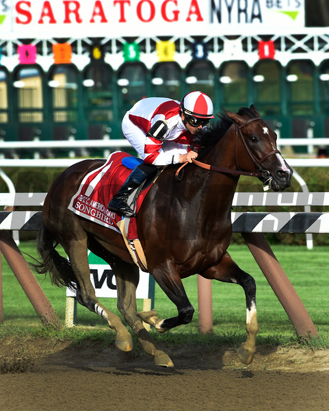 Songbird with jockey Mike Smith outruns the field to win the 100th running of The Coaching Club American Oaks Sunday July 24 2016 at the Saratoga Race Course in Saratoga Springs, N.Y. (Skip Dickstein