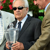 Trainer Jerry Hollendorfer receives the winning trainers trophy from NYRA CEO Chris Kay, right, after Songbird won the 100th running of The Coaching Club American Oaks Sunday July 24 2016 at the Saratoga Race Course in Saratoga Springs, N.Y. (Skip Dickstein