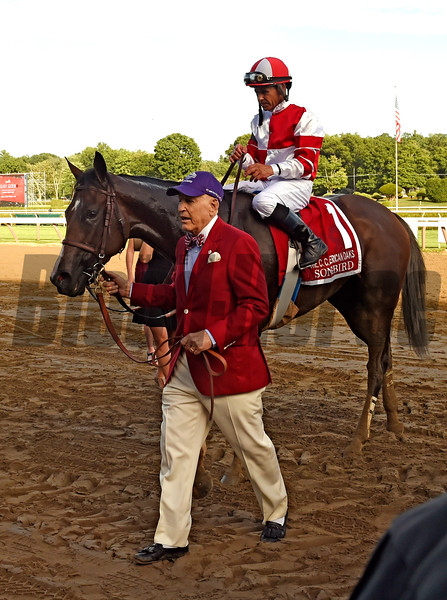 Rick Porter, owner leads Songbird  and Mike Smith to the winner's circle after winning the 100th running of The Coaching Club American Oaks Sunday July 24 2016 at the Saratoga Race Course in Saratoga Springs, N.Y. (Skip Dickstein