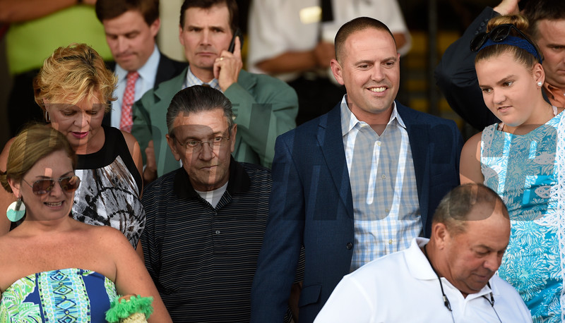 Trainer Chad Brown, second from right is surrounded by family and friends after he recorded his 1000th win with Mr Maybe in the 13th running of The John's Call Wednesday August 24, 2016 at the Saratoga Race Course in Saratoga Springs, N.Y.    <br /> Skip Dickstein Photo