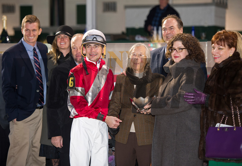 Caption:trainer Ian Wilkes (behind jock), Janis Whitham (brown scarf), Clay Whitham (behind gal in glasses)<br /> Linda with Brian Hernandez Jr. wins the Mrs. Revere (gr. II) for Whitham Thoroughbreds and Ian Wilkes on Nov. 25, 2016, at Churchill Downs.
