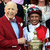 Rich Porter, owner and Mike Smith, jockey hold the winner's trophy after Songbird won the 100th running of The Coaching Club American Oaks Sunday July 24 2016 at the Saratoga Race Course in Saratoga Springs, N.Y. (Skip Dickstein