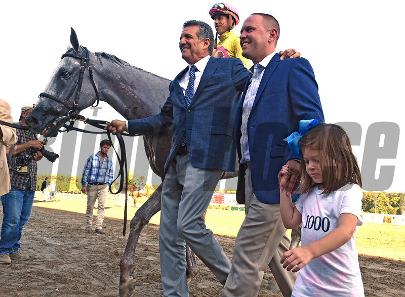 Trainer Chad Brown, second from right recorded his 1000th win as he and principal owner Michael Dubb lead Mr Maybe with jockey Irad Ortiz Jr. to the winner's circle after winning the 13th running of The John's Call Wednesday August 24, 2016 at the Saratoga Race Course in Saratoga Springs, N.Y.    Skip Dickstein Photo