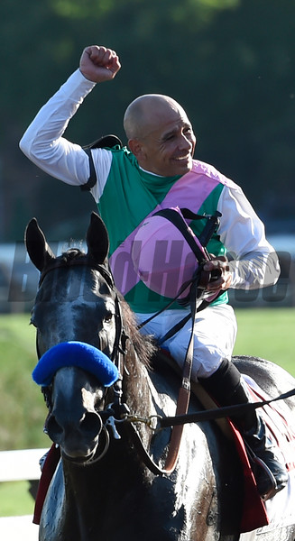Jockey Mike Smith is jublient after winning the 147th running of the Travers Stakes in record time at Saratoga Race Course August 27, 2016 in Saratoga Springs, N.Y.  Photo by Skip Dickstein