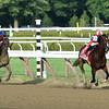Songbird with jockey Mike Smith outruns Carina Mia with jockey Julien Leparoux to win the 100th running of The Coaching Club American Oaks Sunday July 24 2016 at the Saratoga Race Course in Saratoga Springs, N.Y. (Skip Dickstein
