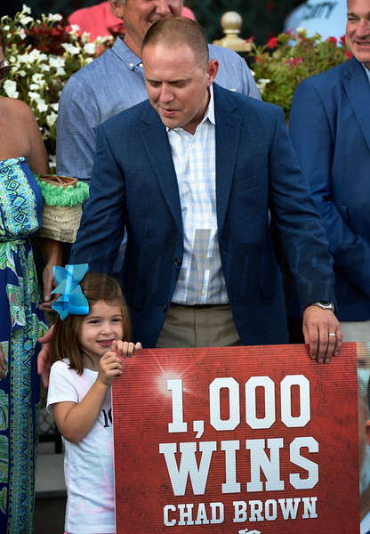 Trainer Chad Brown  is surrounded by family and friends after he recorded his 1000th win with Mr Maybe in the 13th running of The John's Call Wednesday August 24, 2016 at the Saratoga Race Course in Saratoga Springs, N.Y.    <br /> Skip Dickstein Photo
