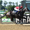 Midnight Bisou wins the Mother Goose Stakes at Belmont Park Saturday, June 30, 2018. Photo: Coglianese Photos/Annette Jasko