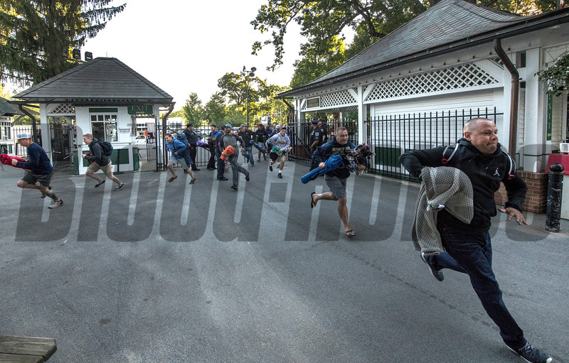 Gates opened and hundreds of racing patrons run for their chance to claim a picnic table for Opening day at the Saratoga Race Course Friday July 20, 2018 in Saratoga Springs, N.Y.  (Skip Dickstein)