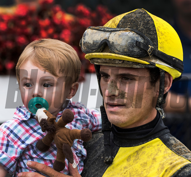 Beckham Wilkes Landeros is held by his father jockey Christ Landeros after winning the 8th running of The Birdstone stake at the Saratoga Race Course Thursday Aug. 2, 2018.  Photo by Skip Dickstein