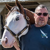 Southern Phantom, a 2-year-old thoroughbred colt stands with trainer Eric Guillot on the grounds of the Oklahoma Training Track adjacent to the Saratoga Race course Wednesday June 20, 2018 in Saratoga Springs, N.Y. (Skip Dickstein/