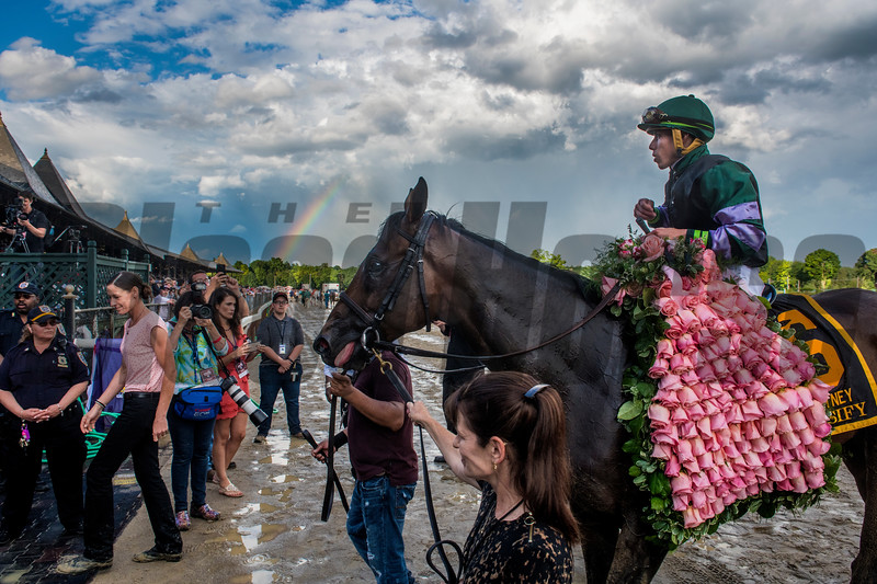 A rainbow blooms in the background as Diversify with jockey Irad Ortiz Jr. enters the winner's circle after winning  the 91st running of The Whitney at Saratoga Race Course Saturday Aug. 3, 2018 in Saratoga Springs, N.Y. <br /> Photo by Skip Dickstein