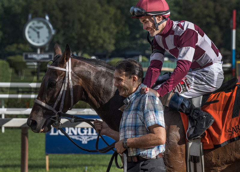 Channing Hill hugs the groom as they enter the winner's circle with Farrell after winning the 42nd running of the Grade III Shuvee at the Saratoga Race Course Sunday July 29, 2018 in Saratoga Springs, N.Y. (Skip Dickstein- Photo)