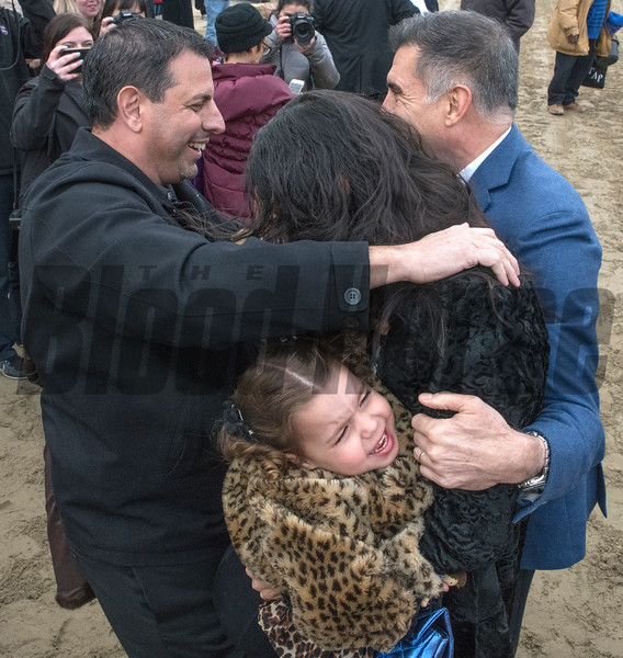 Owners Mike Repole, left and Vince Viola, right celebrate after winning with Vino Rosso with jockey John Velazquez wins the 94th running of The Wood Memorial at Aqueduct Saturday April 7, 2018 in Ozone Park, N.Y. In the scrum is Repole's wife and a crying child.    Photo by Skip Dickstein