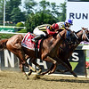 Bee Jersey out duels Mind Your Biscuits to the wire to win the 125th running of the Met Mile at Belmont Park June 9, 2018.      <br /> Dave W. Harmon