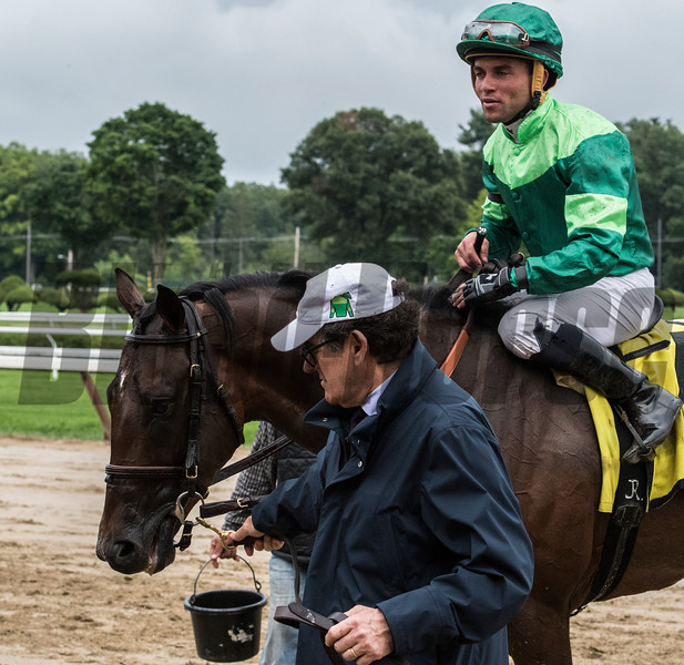 Owner Peter Brandt leads Raging Bull with jockey Joel Rosario to the winner's circle after winning the 34th running of The National Museum of Racing and Hall of Fame stake at the Saratoga Race Course Friday Aug. 3, 2018 in Saratoga Springs, N.Y.  Photo by Skip Dickstein