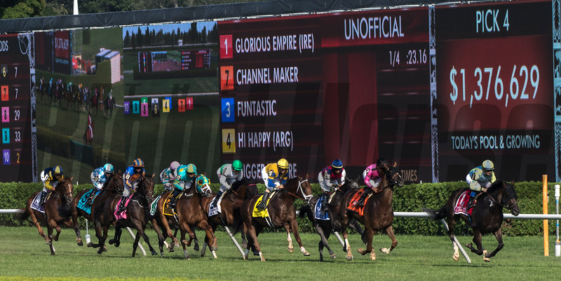 Glorious Empire leads the field past the stands for the first time in the 1 1/2 mile Sword Dancer at the Saratoga Race Course Saturday Aug. 25, 2018 in Saratoga Springs, N.Y.   Photo by Skip Dickstein