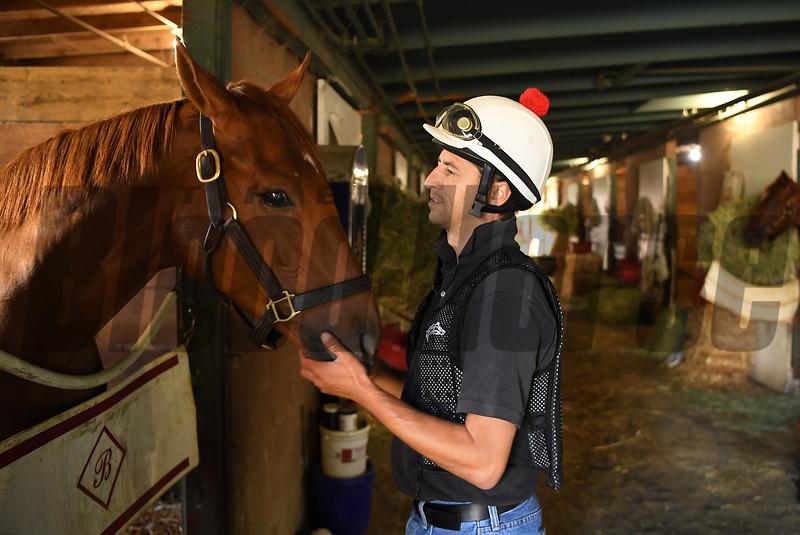 Barn foreman and exercise rider David Meah spends time with Madam Dancealot at the barn of Richard Baltas at Santa Anita. Photo: Wally Skalij