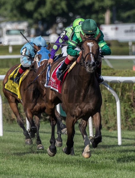 Sistercharlie with jockey John Velazquez looms up on the outside to win the 80th running of The Diana at the Saratoga Race Course Saturday July 21, 2018 in Saratoga Springs, N.Y.   Photo by Skip Dickstein