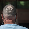 Trainer Eric Guillot got in to the excitement of opening day at the Saratoga Race Course by having this special hair cut done on the back of his head.  Photo by Skip Dickstein