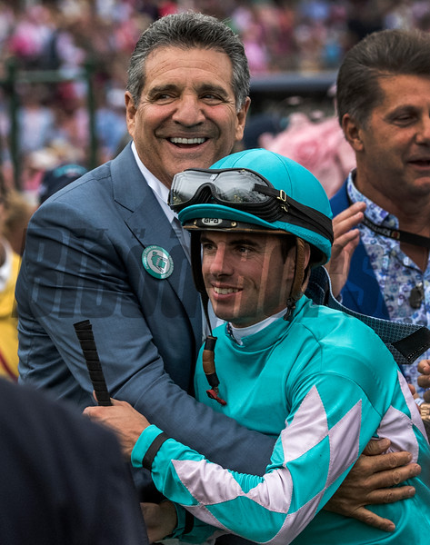 Owner Michael Dubb hugs jockey Florent Geroux after Monomoy Girls wins the 144th running of the Kentucky Oaks at Churchill Downs Friday May 4, 2018 in Louisville Kentucky.  Photo by Skip Dickstein