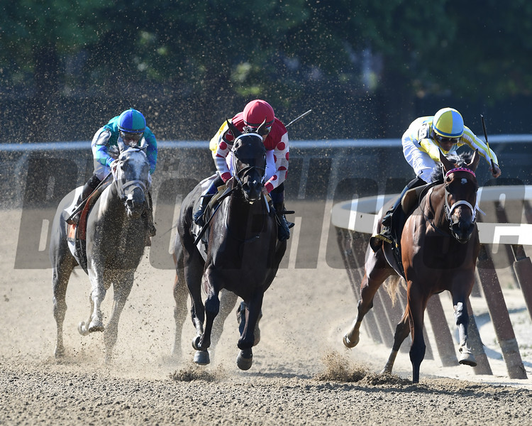 Midnight Bisou (red cap) wins the Mother Goose Stakes at Belmont Park Saturday, June 30, 2018. Photo: Coglianese Photos/Rob Mauhar