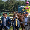 Owners Sol Kumin, Michael Dubb et al walk #4 Monomoy Girl and jockey Florent Geroux to the winner's circle after winning the 102nd running of the Coaching Club American Oaks at the Saratoga Race Course Sunday July 22, 2018 in Saratoga Springs, N.Y.  Photo by Skip Dickstein