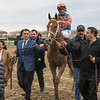 Vino Rosso with jockey John Velazquez is lead to the winner's circle by owner Teresa and Vince Viola, left and Mike Repole, right. and Mrs wins the 94th running of The Wood Memorial at Aqueduct Saturday April 7, 2018 in Ozone Park, N.Y.  Photo by Skip Dickstein