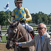 Owner John Oxley leads Catherinethegreat with jockey Jose Ortiz after winning the 100th running of The Schuylerville at the Saratoga Race Course Friday July 20, 2018in Saratoga Springs, N.Y.   Photo by Skip Dickstein