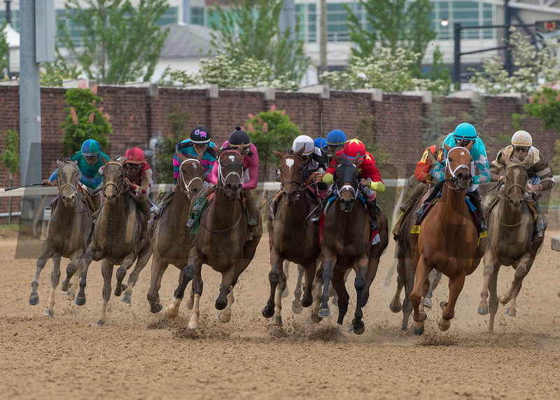 Monomoy Girl, with Florent Geroux (aqua cap) aboard, wins the 144th running of the Longines Kentucky Oaks at Churchill Downs.
