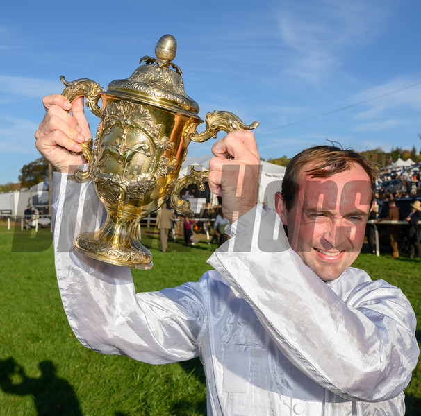 Jockey Nico De Boinvillle holds the winners trophy aloft after he rode Brain Power to the win in  the Grand National G1 at Far Hills Race Meeting in Far Hills, N.J. October 19, 2019. Photo by Skip Dickstein/Tim Lanahan.