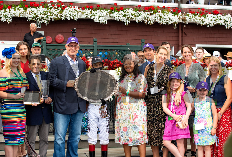 Winning connections and Michael Lund Petersen in the winner's circle after Gamine with John R. Velazquez win the Ketel One Ballerina Handicap (G1) at Saratoga Race Course in Saratoga Springs, N.Y., on Aug. 28, 2021.