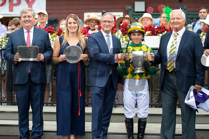 Drew Fleming and winning connections in the winner's circle after Gufo with Joel Rosario win the Resorts World Casino Sword Dancer Stakes (G1T) at Saratoga Race Course in Saratoga Springs, N.Y., on Aug. 28, 2021.